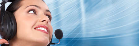 business centre: Beautiful  business woman with headset. Call center. Customer support. Helpdesk.
