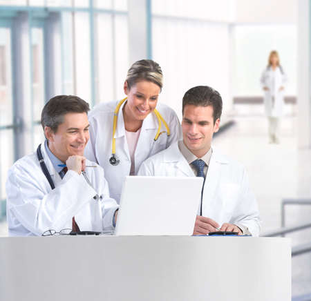 Smiling medical doctors with stethoscopes working with computer. Stock Photo - 7607100