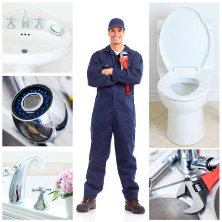 drain: Young plumber fixing a sink   Stock Photo