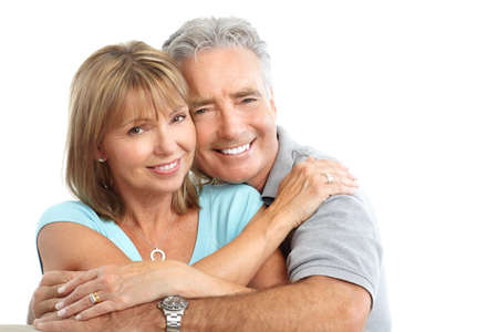 smiling teeth: Happy seniors couple in love. Healthy teeth. Isolated over white background Stock Photo