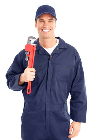 adjustable wrench: Young handsome plumber worker with adjustable wrench. Isolated over white background