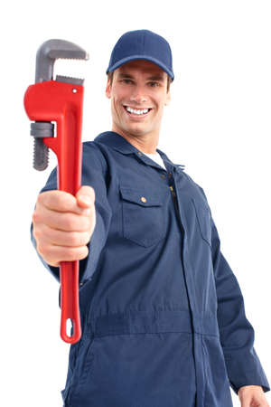 Young handsome plumber worker with adjustable wrench. Isolated over white background  photo