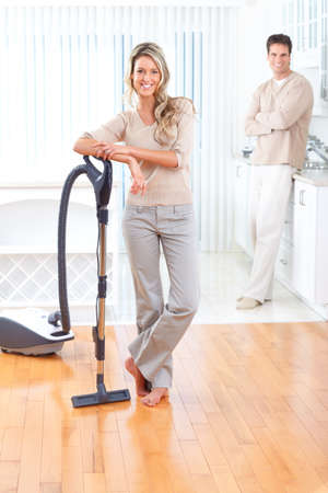 house cleaner: House work, vacuum cleaner, young couple, home, kitchen. Housework