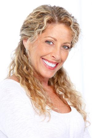 Smiling happy elderly woman. Isolated over white background  photo