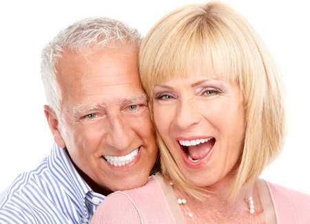 tooth whitening: Happy seniors couple in love. Healthy teeth. Isolated over white background  Stock Photo