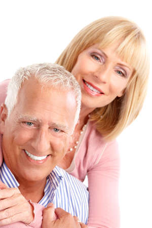 Happy seniors couple in love. Healthy teeth. Isolated over white background Stock Photo - 7702747