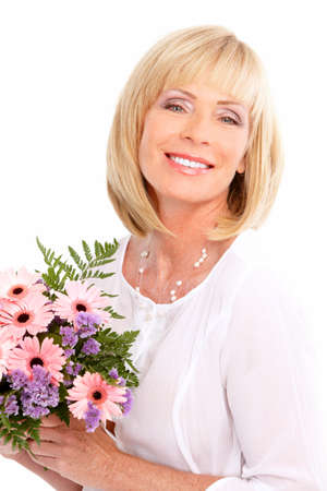 Smiling happy elderly woman with flowers. Isolated over white background