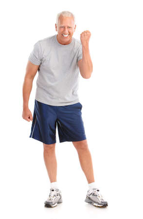 Gym & Fitness. Smiling elderly man  working out. Isolated over white background  Stock Photo