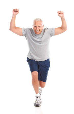 Gym & Fitness. Smiling elderly man  working out. Isolated over white background  Фото со стока