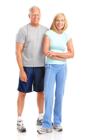 weight loss man: Gym & Fitness. Smiling elderly couple working out. Isolated over white background