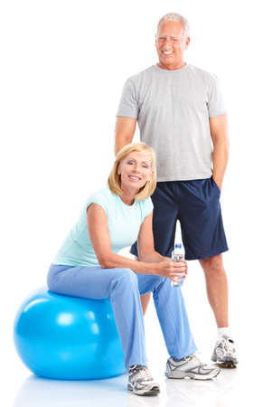 Gym & Fitness. Smiling elderly couple working out. Isolated over white background Stock Photo - 7702540