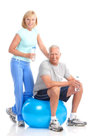 older men: Gym & Fitness. Smiling elderly couple working out. Isolated over white background