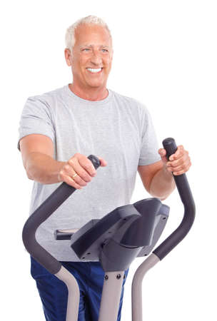 Gym & Fitness. Smiling elderly man  working out. Isolated over white background  photo