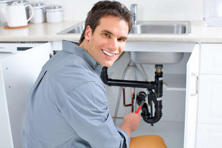 Young plumber fixing a sink Stock Photo - 7702873