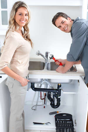 Young plumber fixing a sink  Stock Photo - 7702909