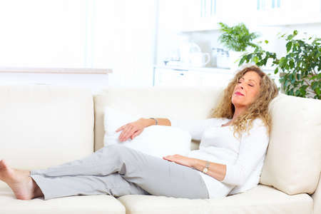 woman on couch: Relaxing woman on the sofa at home