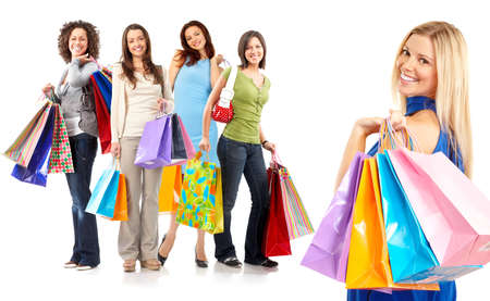 Happy shopping women. Isolated over white background  photo