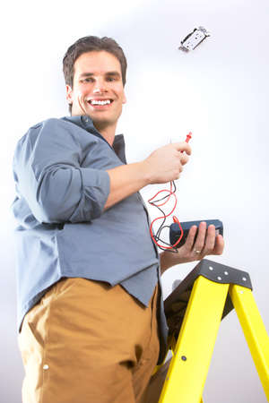 Young smiling electrician doing his work  photo