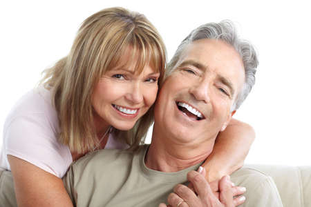 Happy seniors couple in love. Healthy teeth. Isolated over white background  Фото со стока
