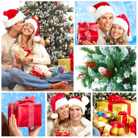 christmas backgrounds: Young happy couple near  a Christmas tree Stock Photo