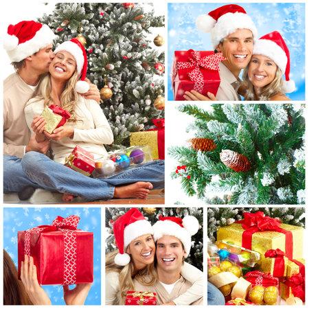 couple winter: Young happy couple near  a Christmas tree Stock Photo