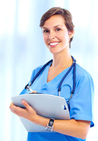 Young smiling medical nurse with stethoscope.   photo