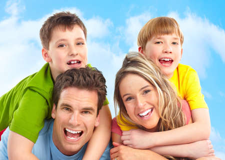 dental smile: Happy family. Father, mother and boy outdoors  Stock Photo