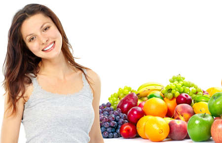 Young smiling woman  with  fruits and vegetables. Over white background Stock Photo - 7723556