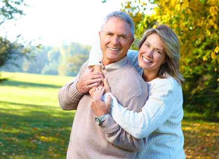 a couple: Happy elderly seniors couple in park  Stock Photo