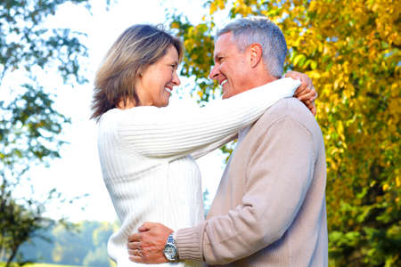 mature couple: Happy elderly seniors couple in park  Stock Photo