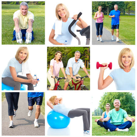 Happy elderly seniors doing fitness in park