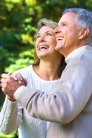 Happy elderly seniors couple in park Stock Photo - 7726395