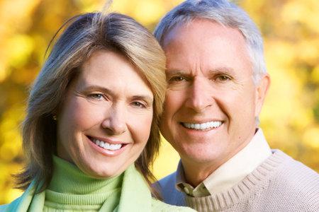 older couple: Happy elderly seniors couple in park  Stock Photo