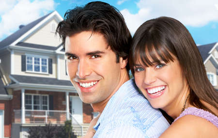 finances: Young love couple a new home.  Real estate concept