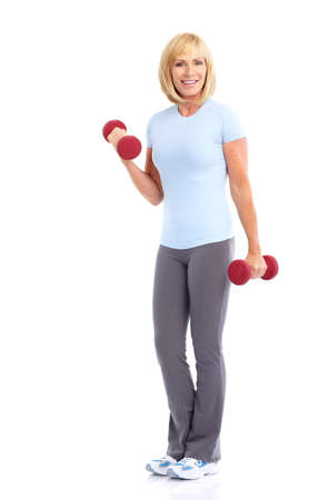Gym & Fitness. Smiling elderly woman working out. Isolated over white background 版權商用圖片 - 7833984