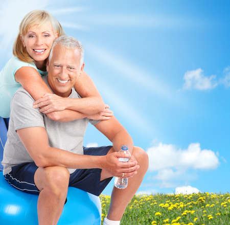 Happy elderly seniors couple working out in park Stock Photo - 7834051