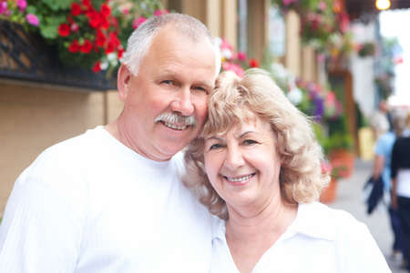 Smiling happy senior couple in the city  photo