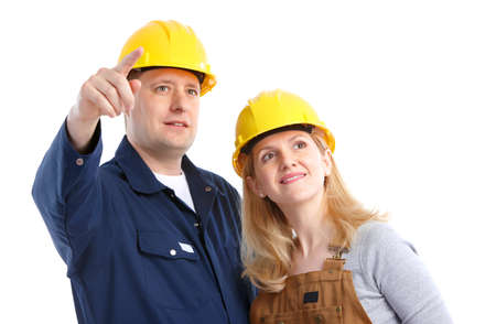 Young handsome builder workers. Isolated over white background  photo