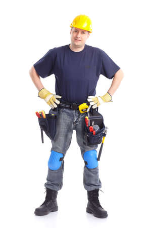 Young handsome builder in yellow uniform. Isolated over white background Stock Photo - 7872645