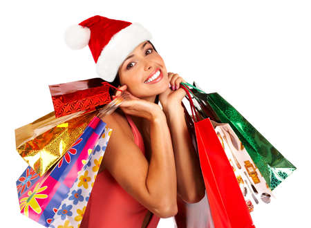 Christmas shopping woman. Isolated over white background  photo