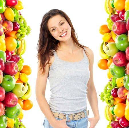 Giovane donna sorridente con frutta e verdura. Su sfondo bianco  Archivio Fotografico