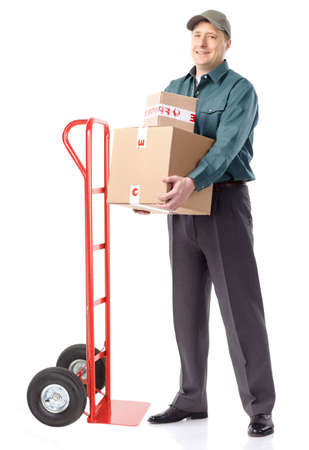 Delivery worker with hand truck. Isolated over white background  photo