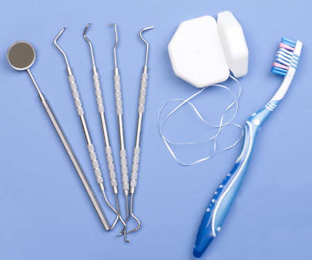 dental tools: Dental tools, floss and toothbrush. Over blue  background