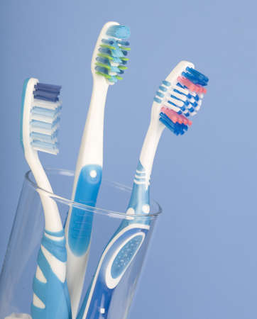 tooth brushes. Over blue background  photo