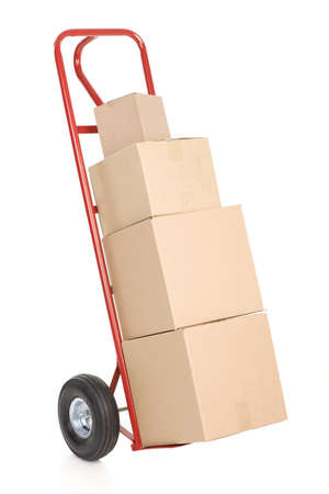 delivery service: Red hand truck with boxes. Isolated over white background Stock Photo