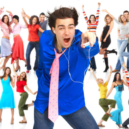 listening device: Happy young man with mp3-player and young people Stock Photo