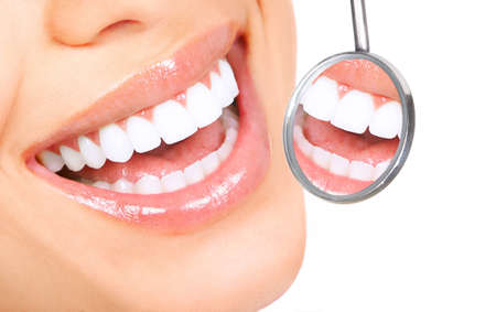 Healthy woman teeth and a dentist mouth mirror Stock Photo - 8074340
