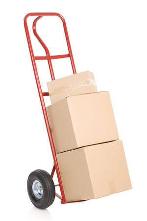 Red hand truck with boxes. Isolated over white background photo