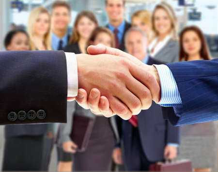 handskakning: Business handshake and business people  Stockfoto