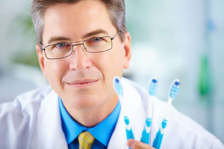 dentist with toothbrushes in the office
